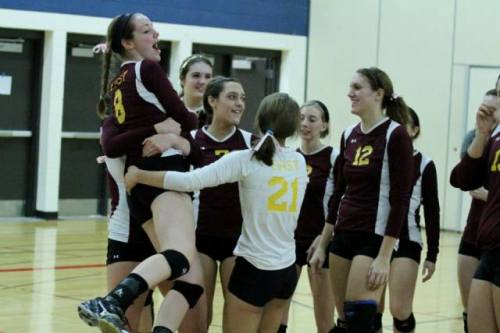 Senior Delaney McCreary is lifted by her teammates after East volleyball defeated Slinger to win the conference championship.  McCreary is one of nine seniors leaving the team.