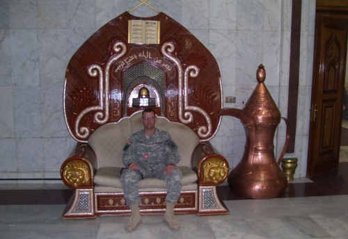 Bill Greymont sits at the Al-Faw palace in Baghdad. The chair was a gift from Yasser Arafat to Saddam Hussein in recognition of his support for the Palestinian cause.