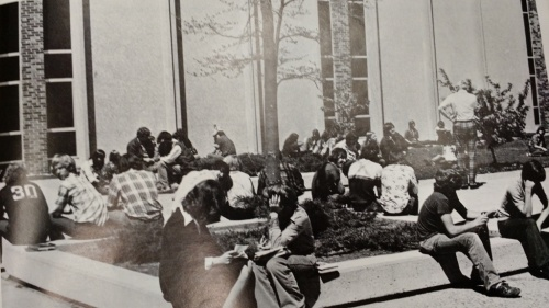 Students relax in the courtyard, as pictured in the 1975 West Bend High Schools yearbook.  It was common for students to congregate in the courtyard through the 1990s.